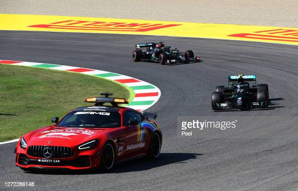 An FIA safety car leads Valtteri Bottas of Finland driving the Mercedes AMG Petronas F1 Team Mercedes W11 during the F1 Grand Prix of Tuscany at...