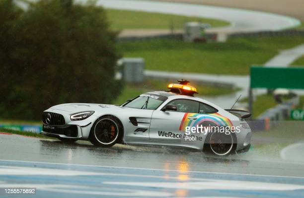 An FIA safety car with 'WeRaceAsOne' branding is seen on track during qualifying for the Formula One Grand Prix of Styria at Red Bull Ring on July...