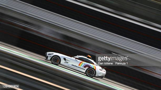 An FIA safety car with 'WeRaceAsOne' branding is seen on track during previews ahead of the F1 70th Anniversary Grand Prix at Silverstone on August...