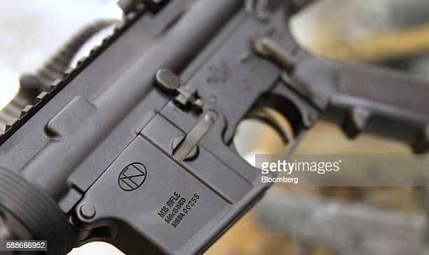 An FN Herstal SA AR15 rifle is on display for sale at a gun store in Orem Utah US on Thursday Aug 11 2016 The constitutional right of Americans to...