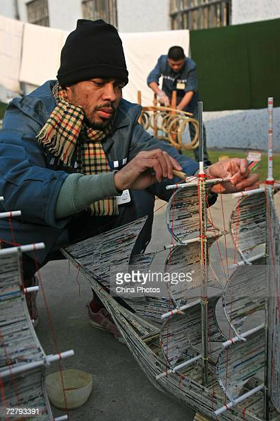 An foreign inmate makes a sailboat model as preparation for Christmas at the Shanghai Qingpu Prison on December 10 2006 in Shanghai China As the only...