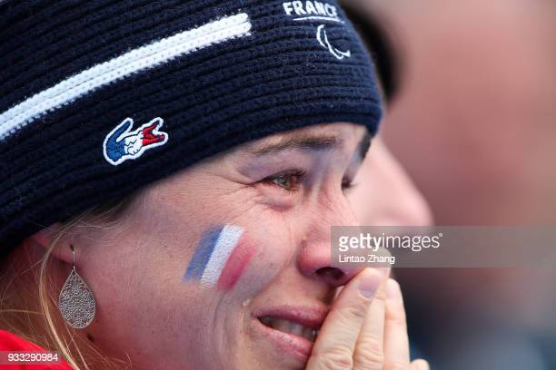 An France coach cry during the medal ceremony for the Alpine Skiing Women's Slalom Standing Run 2 during day nine of the PyeongChang 2018 Paralympic...