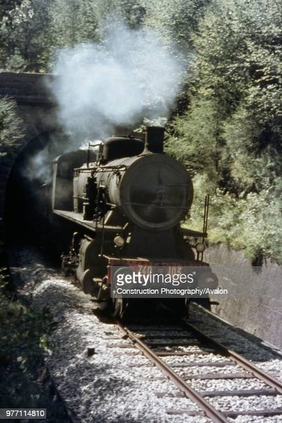 An FS Italian Railways 740 Class 280 emerges from the tunnel at Santa Croce with a passenger train from Venice to Belluno on Saturday 28th August 1971