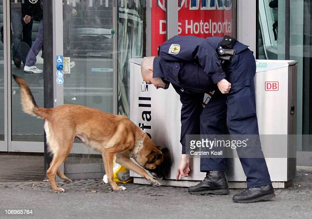 An german policeman examined with a police dog a dustbin in front of the entrance to the main station on November 19 2010 in Berlin Germany Germany's...