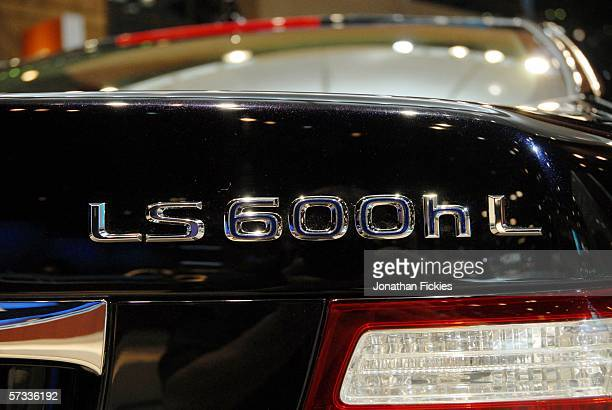 An 'h in the badge of the 2007 Lexus LS600hL luxury sedan designates the vehicle as a gasolineelectric hybrid during the press preview of the 2006...