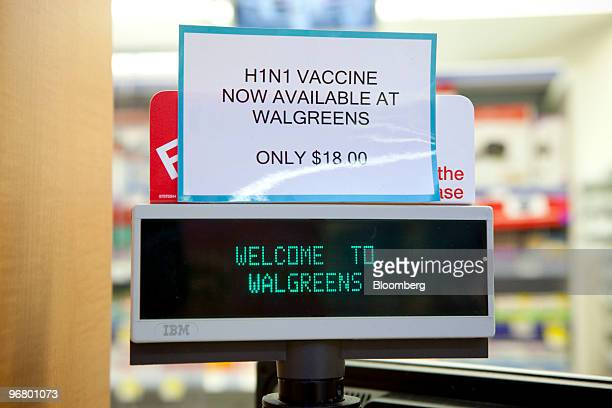 An H1N1 vaccine sign sits at the Walgreen's pharmacy in New York US on Wednesday Feb 17 2010 Walgreen Co the biggest US drugstore chain agreed to buy...