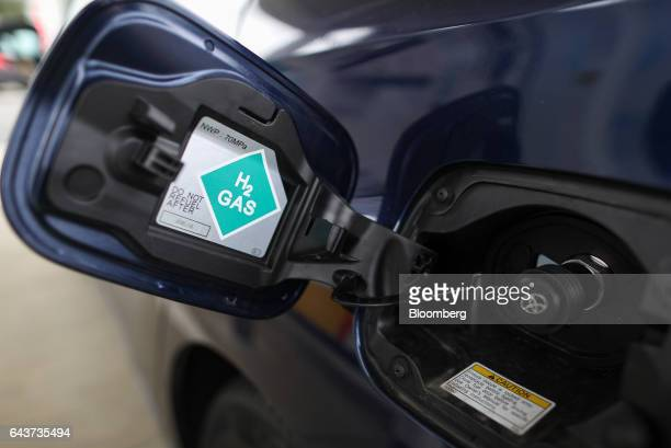 An H2 sign is displayed on the fuel cap door of a Mirai hydrogen fuel powered automobile manufactured by Toyota Motor Corp at Royal Dutch Shell Plc's...