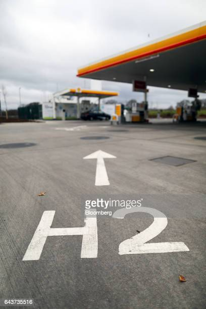 An H2 sign painted on the forecourt directs vehicles towards Royal Dutch Shell Plc's hydrogen refueling pumps at their first UK hydrogen fuel station...