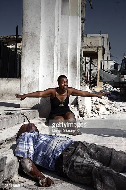 An Haitian woman mourn next to the body of his brother an Haitian american citizen who was shoot dead in the street as he got rob on February 8 2010...