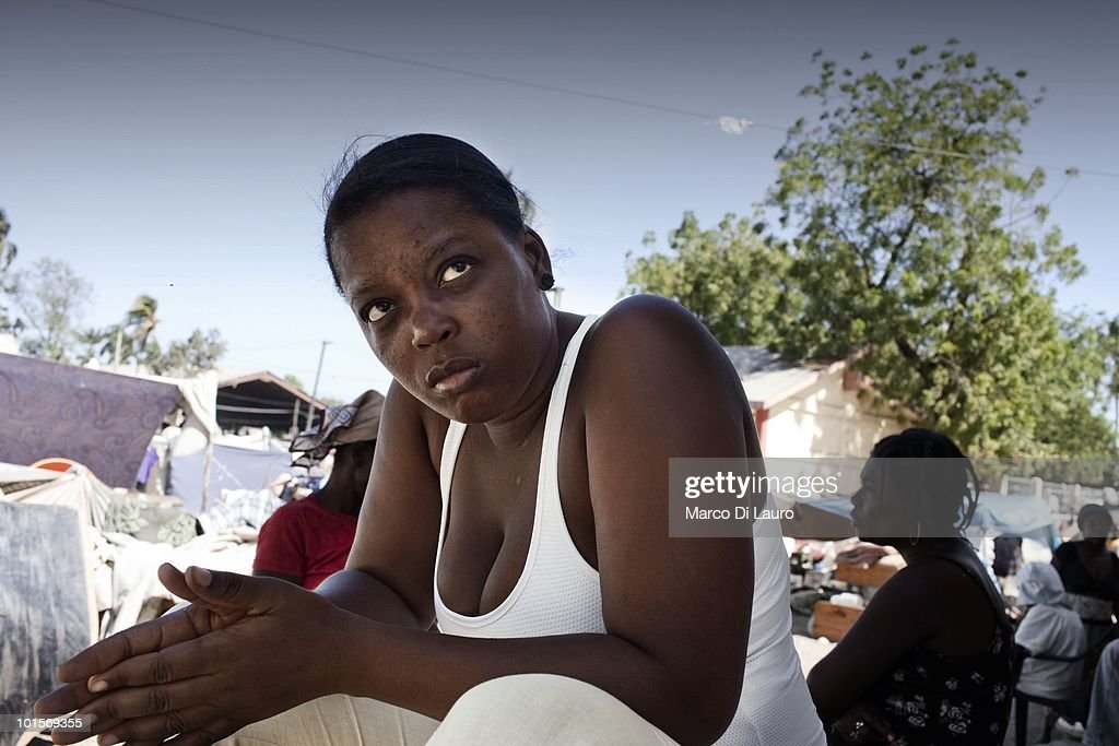 An Haitian woman seats near a Save The Children NGO Mobile clinic as she wait to be treated in a temporary camp on January 29, 2010 in Port Au Prince, Haiti. As many as 200,000 people died on January 12 as a consequence of the 7.0-magnitude earthquake. At least 130 people have been pulled alive from the rubble. An estimated 1.5 million people have been left homeless. The Haitian government is planning to relocate some 400,000 people, currently in makeshift camps across the capital, to temporary tent villages outside the city. Aid agencies are still struggling to supply food and water to survivors, while thousands of Haitians who suffered serious injuries remain in need of urgent medical attention.