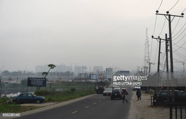 An hazy skyline envelopes in the city of Port Harcourt Rivers State on February 14 2017 The Nigerian city of Port Harcourt used to be known as 'The...