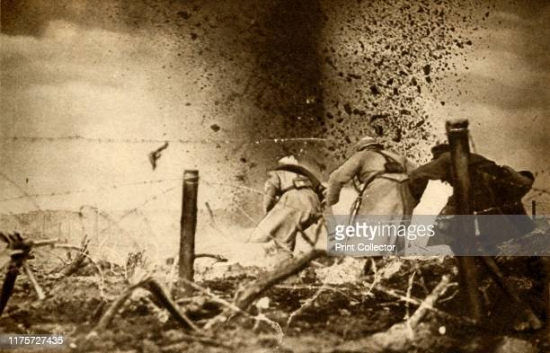 An HE shell exploding' First World War 19141918 Battlefield scene capturing the blast from a highexplosive shell on the front line From The Pageant...
