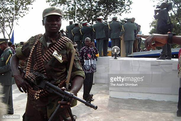 An heavily armed Angolan soldier stands guard as the funeral of assassinated President LaurentDesire Kabila is held on January 23 2001 in Kinshasa...