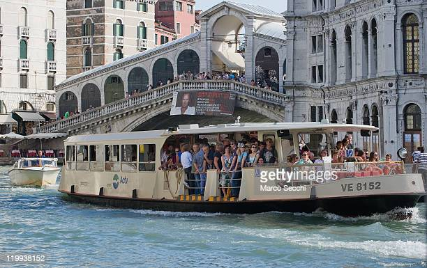 An heavily crowed vaporetto sails the Grand Canal near Rialto Bridge on the day when the municipality has opened seperate lanes for tourists and...