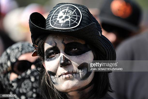 An heavy metal fan poses for a photograph during the Hellfest hardrock music Festival on June 20 2014 in Clisson western France AFP PHOTO /...