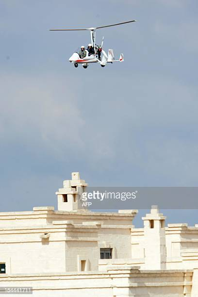 An helicopter flies above the Bagno Egnazia resort in Fasano in the southern Italian region of Puglia on October 20 where US actors Justin Timberlake...