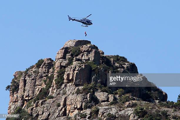An helicopter flies over RoquebrunesurArgens on June 28 2011 during a massive search for murder suspect Xavier Dupont de Ligonnes after French...