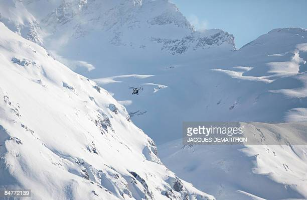 An helicopter of the French gendarmerie patrols before the men's giant slalom 1st run at the World Ski Championships on February 13, 2009 in Val...