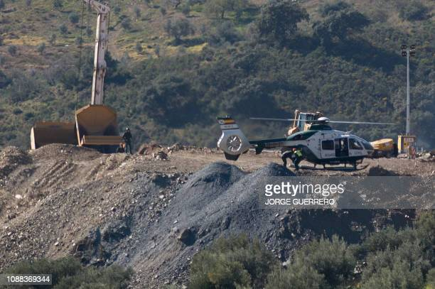 An helicopter of the Spanish Guardia Civil transporting explosives lands at the site where a child fell down a well in Totalan southern Spain on...