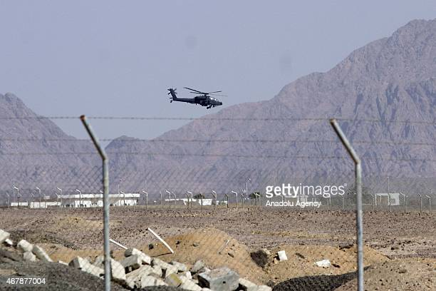 An helicopter patrols around the congress hall before 26th Arab League Summit in the Red Sea resort of Sharm ElSheikh Egypt on March 28 2015 26th...