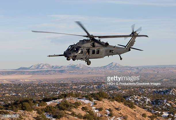 an hh-60g pave hawk from the 512th rqs flies a low level route during a training mission out of kirtland air force base, new mexico. - military helicopter stock photos and pictures
