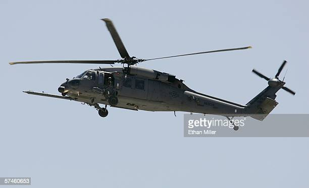 An HH60G Pavehawk helicopter practices maneuvers at Nellis Air Force Base April 25 2006 in Las Vegas Nevada