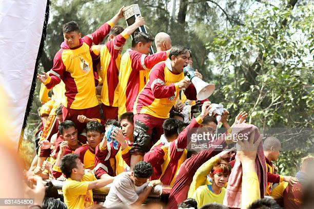 AVE MANILA NCR PHILIPPINES An hijo del Nazareno tries to direct devotees gathered around the andas of the Black Nazarene via a megaphone during the...