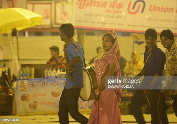An Hindu eunuch with his group members walks at Sangam the confluence of the rivers Ganges Yamuna and the mythical Saraswati on the eve of 'Mauni...