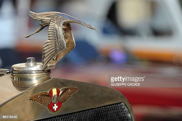 An Hispano Suiza classic car stands parked in Piazza del Duomo prior to the seventh revival of the Coppa MilanoSanremo in Milan on March 13 2009 The...