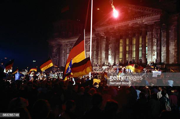 An historic evening in West Germany as East Germany rejoins its Western counterpart Flagwaving crowds gather in front of the Reichstag