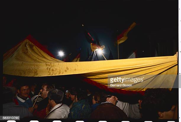 An historic evening in West Germany as East Germany rejoins its Western counterpart Flagwaving crowds gather in the streets of Berlin