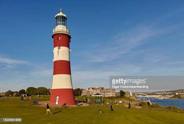 an historic monument at an historic place, smeaton's tower, on plymouth hoe, in the city of plymouth, devon, england, united kingdom, europe - ホー ストックフォトと画像