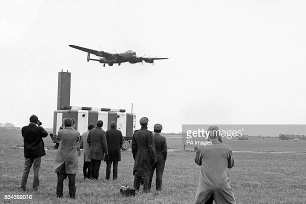 """An historic silhouette over Scampton as a Lancaster bomber """"beats up"""" the runway on its arrival after a commemorative flight from Biggin Hill, Kent...."""