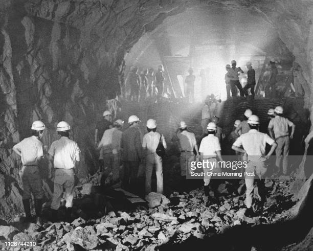 An historic subterranean rendezvous in 1977 when two teams of miners tunnelling towards each other make a breakthrough on the Mass Transit Railway...