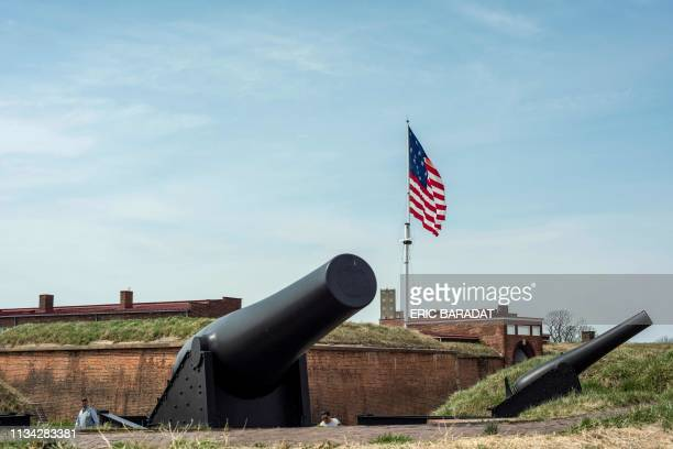 An historical American flag flies over Fort McHenry in Baltimore on March 30 2019 as tourist visit the historical monument Fort McHenry is a...