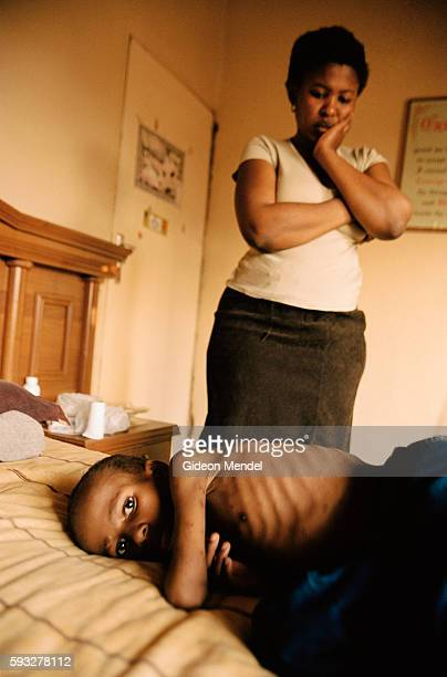 An HIV positive woman with her 10yearold child who has AIDS and is extremely ill Neither of them were able to access the antiretroviral therapy...