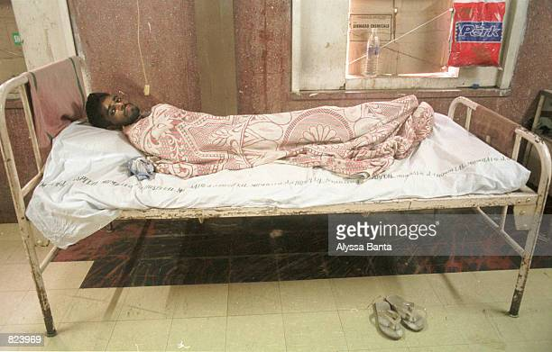An HIV postitive patient lays in his bed February 20 2001 at the J J Hospital in Bombay India The pharmaceutical company Cipla announced it will sell...