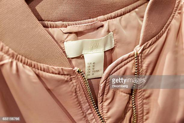 An HM logo sits on the label of a pink bomber jacket inside a Hennes Mauritz AB retail store in Stockholm Sweden on Tuesday Jan 31 2017 Hennes...