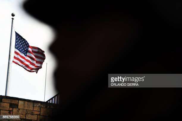 An Honduran Army soldier stand guard in front of the United Stated embassy in Tegucigalpa as supporters of presidential candidate for Honduras'...