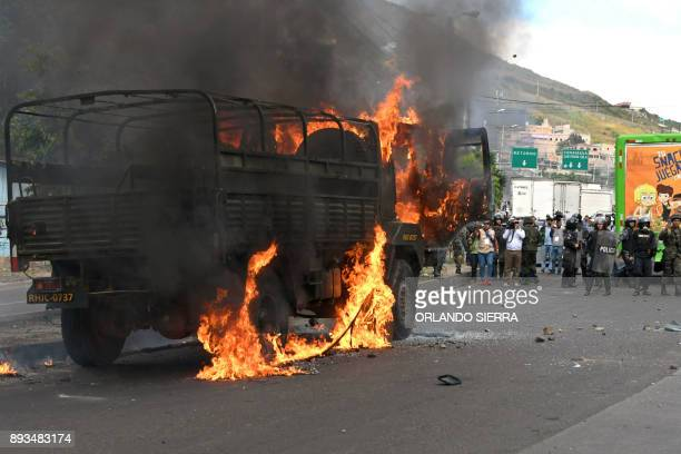 An Honduran Army truck is set alight as supporters of presidential candidate for the Opposition Alliance against Dictatorship party Salvador Nasralla...