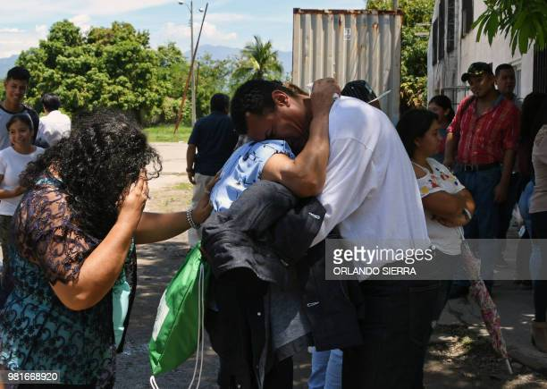 An Honduran immigrant is received by his family at the Ramon Villeda Morales airport in San Pedro Sula 200 kilometres north of Tegucigalpa after...