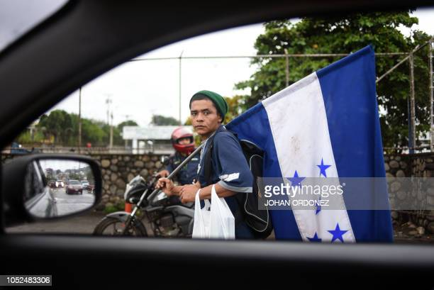 TOPSHOT An Honduran migrant heading in a caravan to the United States arrives in Mazatenango Suchitepequez departament 160 km south of Guatemala City...