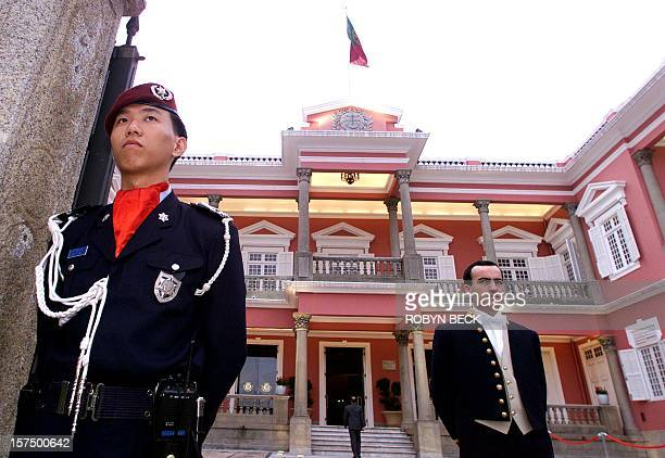 An honor guard and a protocol officer await the arrival of Portuguese President Jorge Sampaio and Macau Governor Vasco Rocha Vieira at the Government...