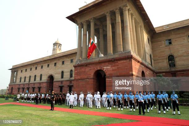 An honor guard awaits the arrival of Mark Esper, U.S. Secretary of defense, during a ceremonial reception at the South Block lawns in New Delhi,...