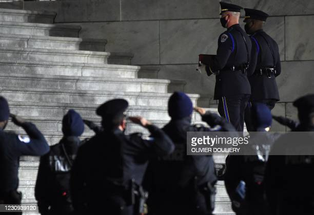 An honor guard carries an urn with the cremated remains of US Capitol Police officer Brian Sicknick up the steps of the US Capitol to lie in honor in...