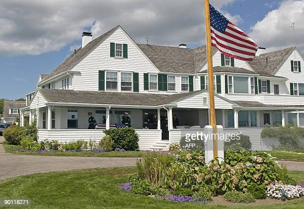 An Honor Guard carries the casket of the late US Sen Edward Kennedy across the porch of his home at the Kennedy compound in Hyannis Port...
