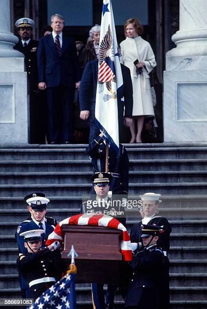 An honor guard carries the coffin of American politician and former US Vice President Hubert Humphrey down the steps of the US Capitol Building...