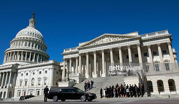 An honor guard carries the flag draped casket of Sen Robert Byrd up the Senate stairs on the US Capitol on July 1 2010 in Washington DC Byrd a...