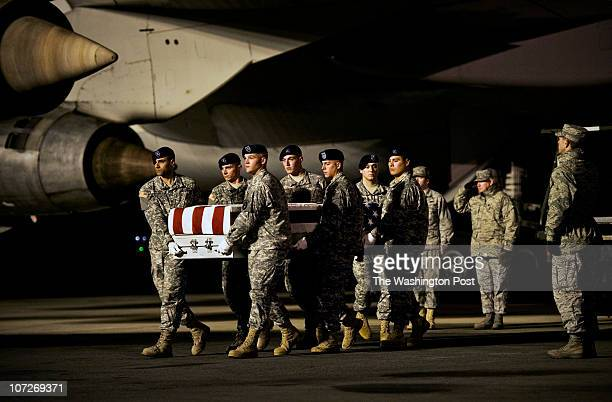 An honor guard delivers the flag draped casket containing the remains of Jacob A Gassen of Beaver Dam Wisconsin killed in an ambush last monday in...