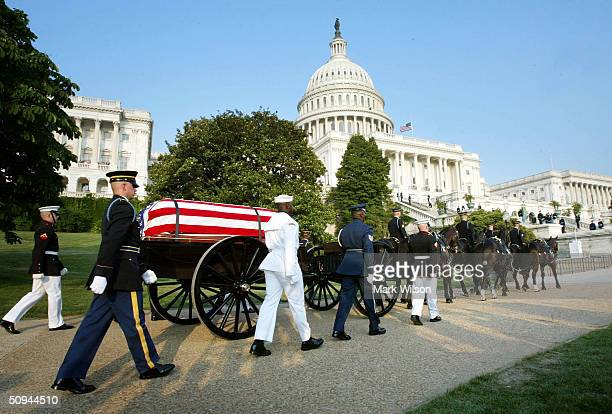 An honor guard escorts the caisson carrying former President Ronald Reagan to the US Capitol June 9 2004 in Washington DC The 40th US President will...
